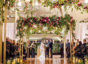 wedding ceremony with flower bower
