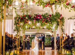wedding ceremony with flower bower