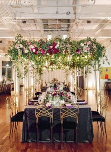 decorated reception table with flowers hanging above